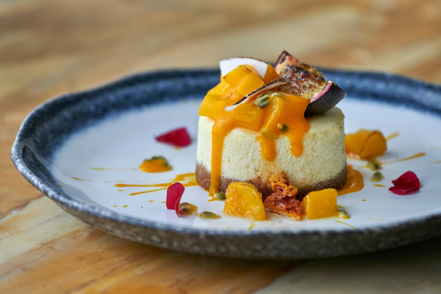 The baked cheesecake with passion fruit, coconut & mango is available at Italian restaurant Daphne's