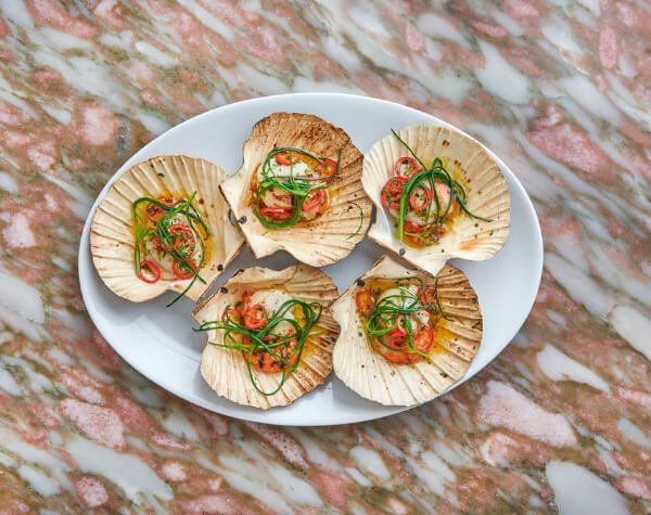 The Scallops are available at Daphne's, a romantic restaurant in Kensington, ideal for date nights